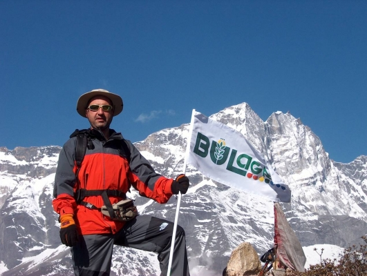 "The company's flag is raised on ""The roof of the world""- the Chukhung Ri mount in the Himalayas"